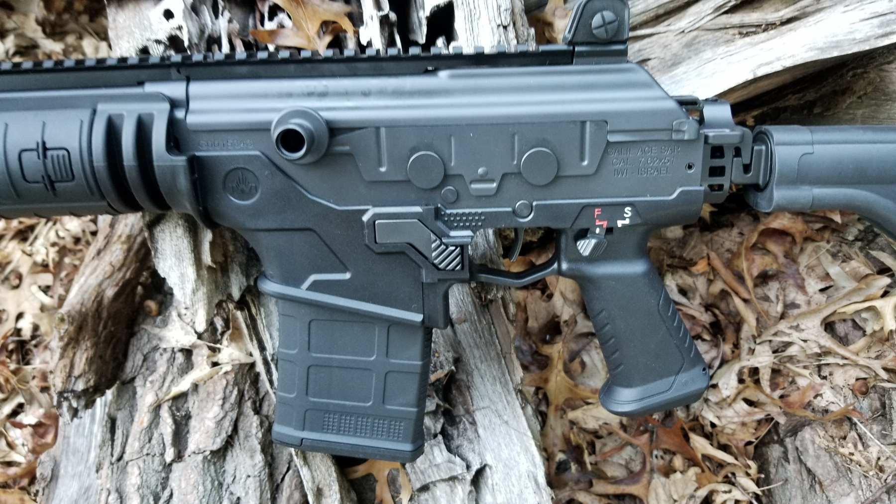 View of charging handle and shutter system that seals the receiveer's track.