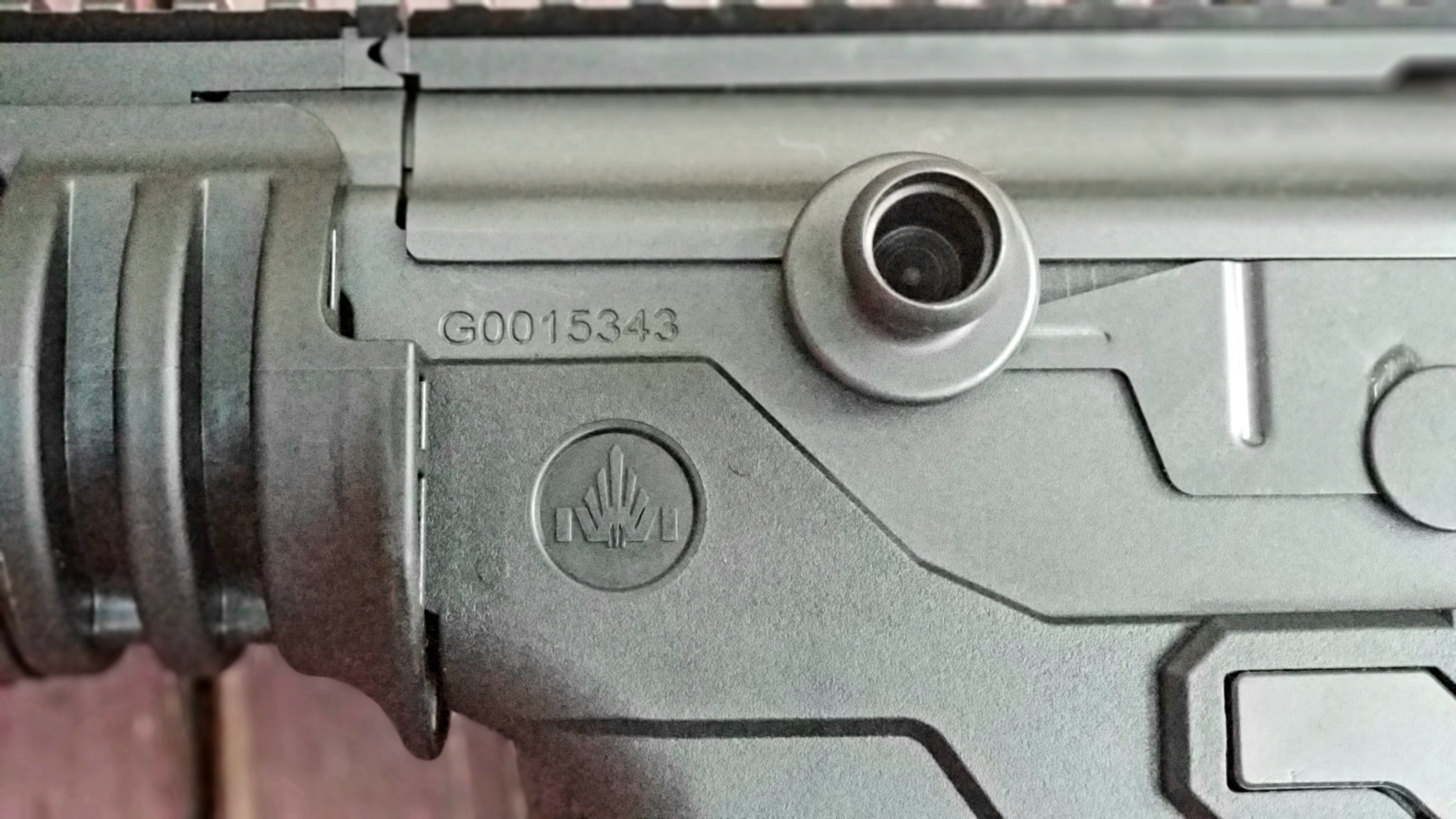 The charging handle is a hollow tube to reduce weight