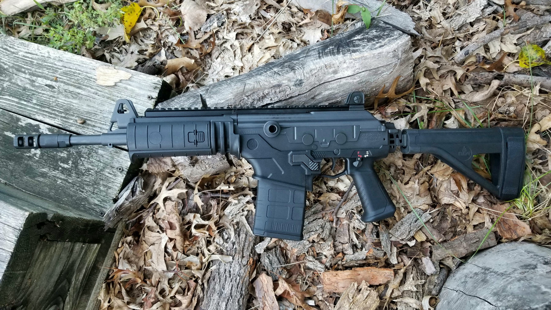 Non-operating side.  The pistol uses Magpul LR/SR magazines.