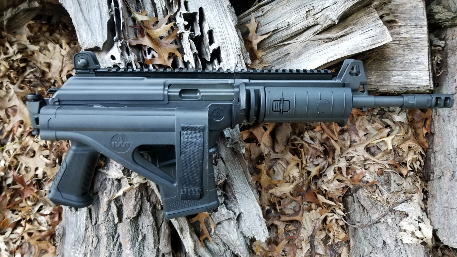 SOB brace folded. Note how it is below the ejection port.  The front sight is protected.