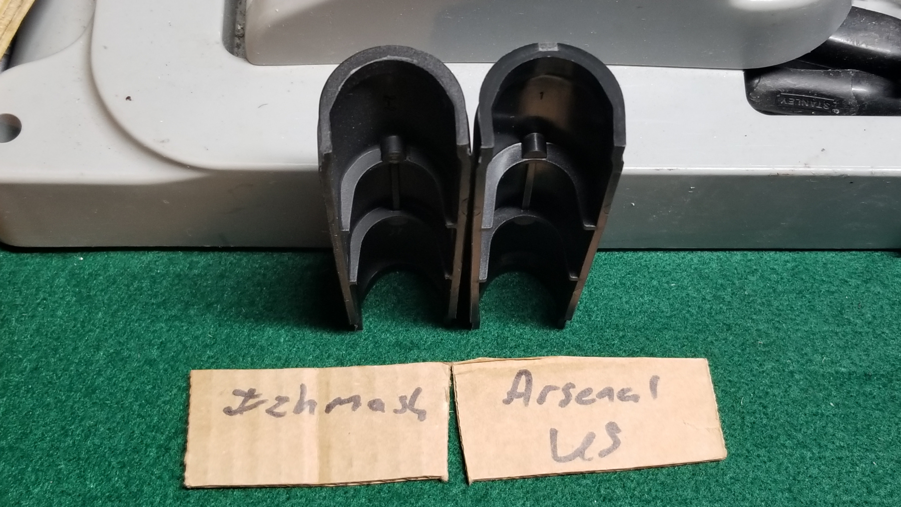 (L) Izhmash and (R) Arsenal US. izhmash has sebbled teture even on the back surface. Arsenal US is smooth.