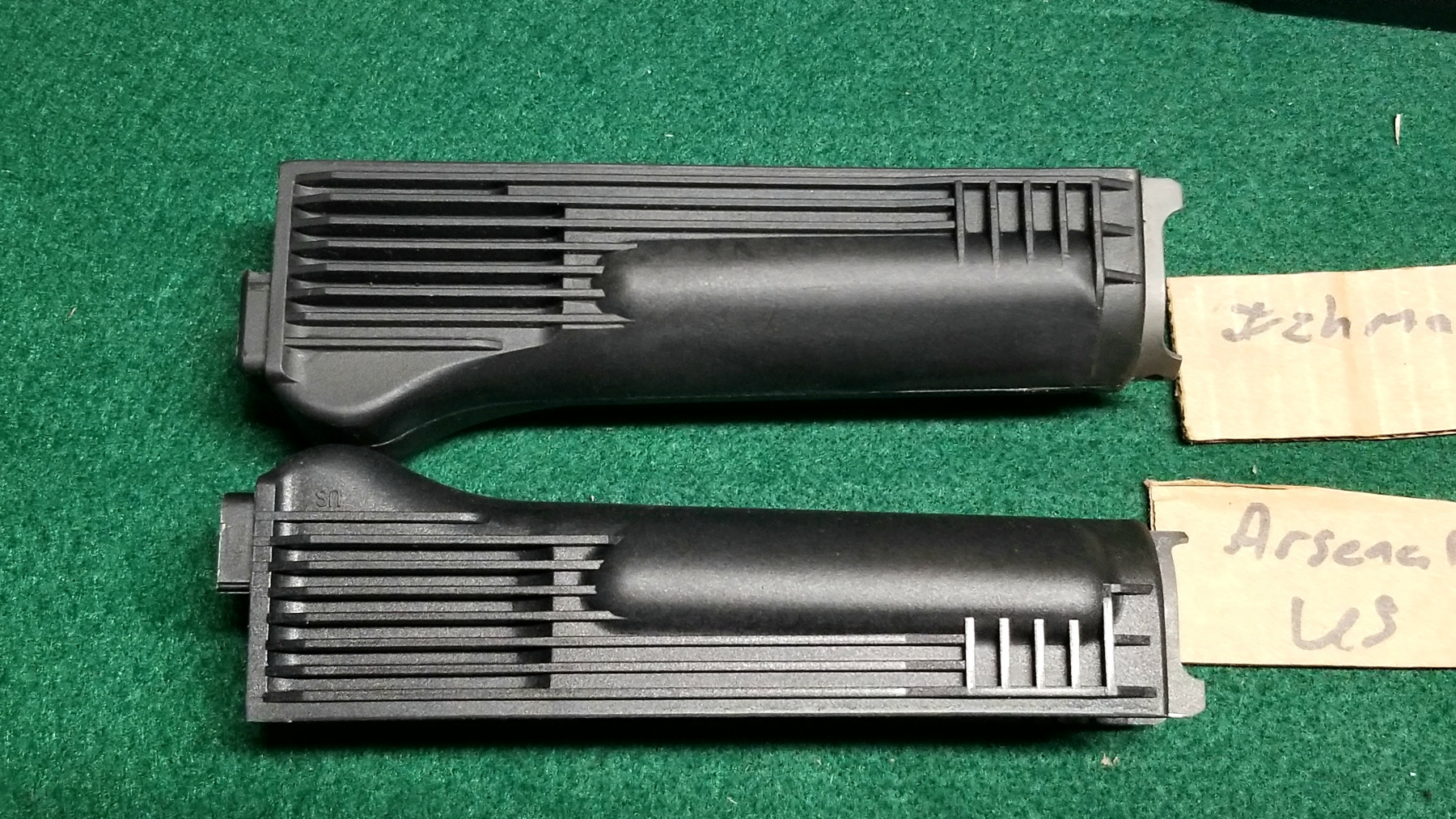 Top is Izhmash and Lower is Arsenal US. Clear shot of the differences in the rear lower swell of the handguards.