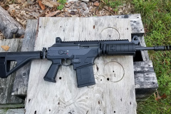 Operating side.  note the long sight radius, combo gas/sight block and full length top Picatinny rail.  Note the short handguard and that the bottom rail cover has an integral hand stop.