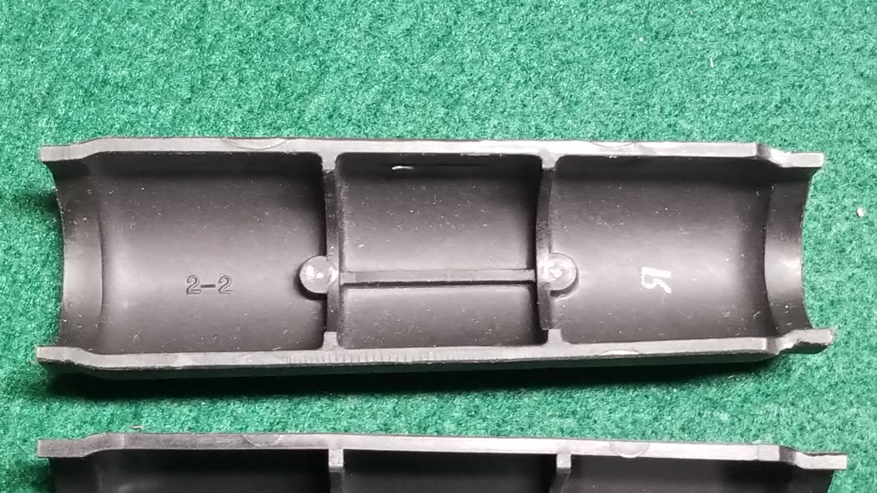Upper is Izmash fast tube cover. Lower is Arsenal US.  Note the 2-2 mold ID.